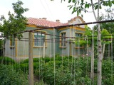 A trim house with a large yard for sale, in the village of Neofit Rilski