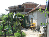 Two-storey house with yard in picturesque rural area