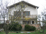 Two-storey villa with garden in quiet village