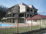 Hotel complex with swimming pool, gas station and large plot in Etropole