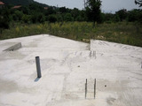 Regulated land plot with foundation