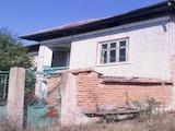 Селски имот с двор, за ремонт, на 15 км от гр. Свищов