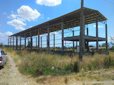 Investment land with metal building for industrial purposes