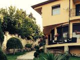 Двуетажна къща с двор и два гаража в местност Траката