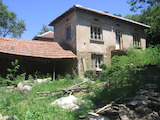 Two-storey rural house with yard in picturesque hilly area