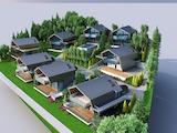 Парцел в регулация с примерен проект за изграждането на осем еднофамилни двуетажни къщи